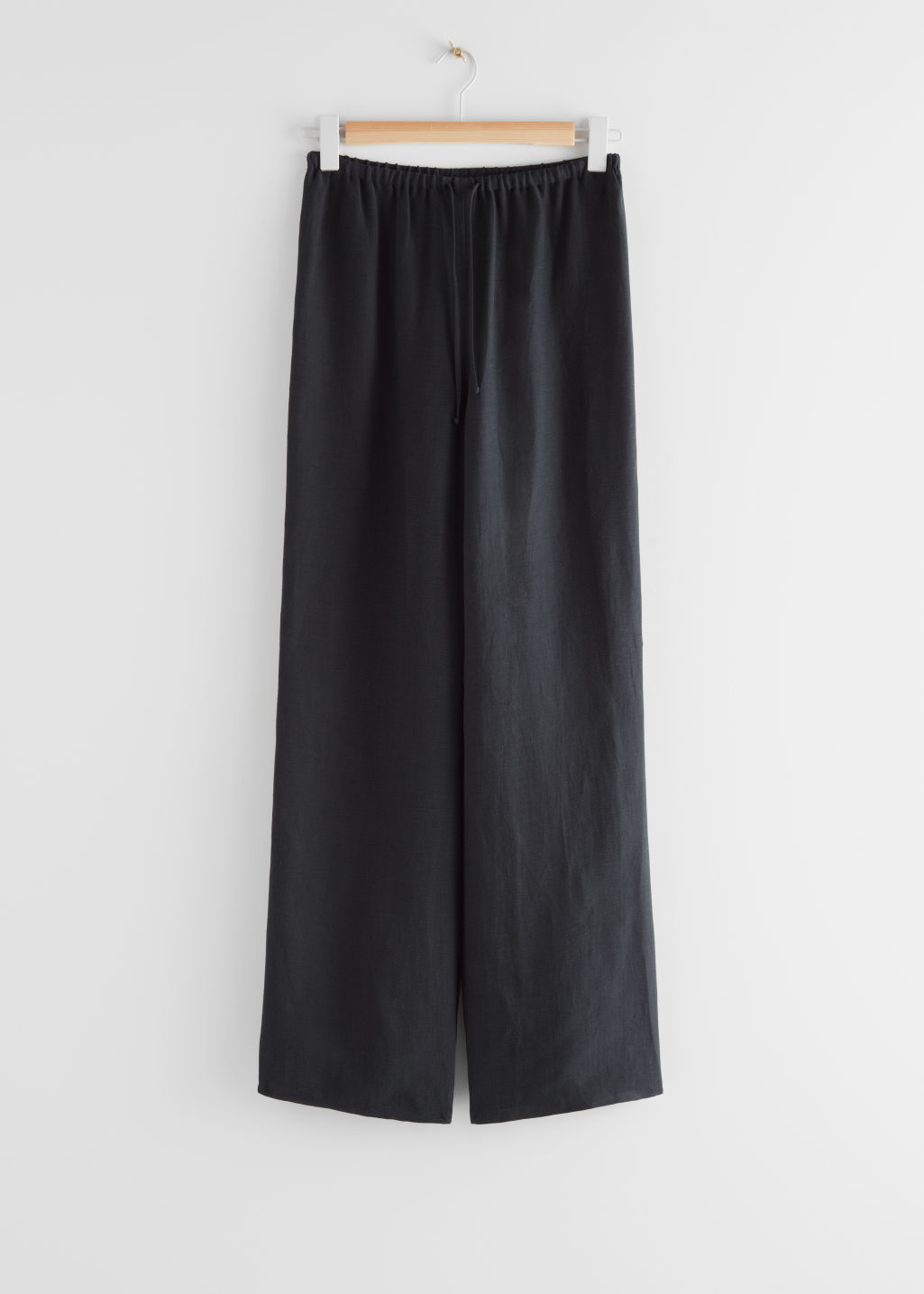 StillLife Front Image of Stories Flared Linen Blend Trousers in Black