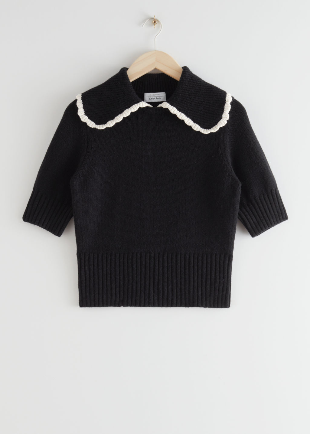 StillLife Front Image of Stories Wide Collar Wool Knit Sweater in Black