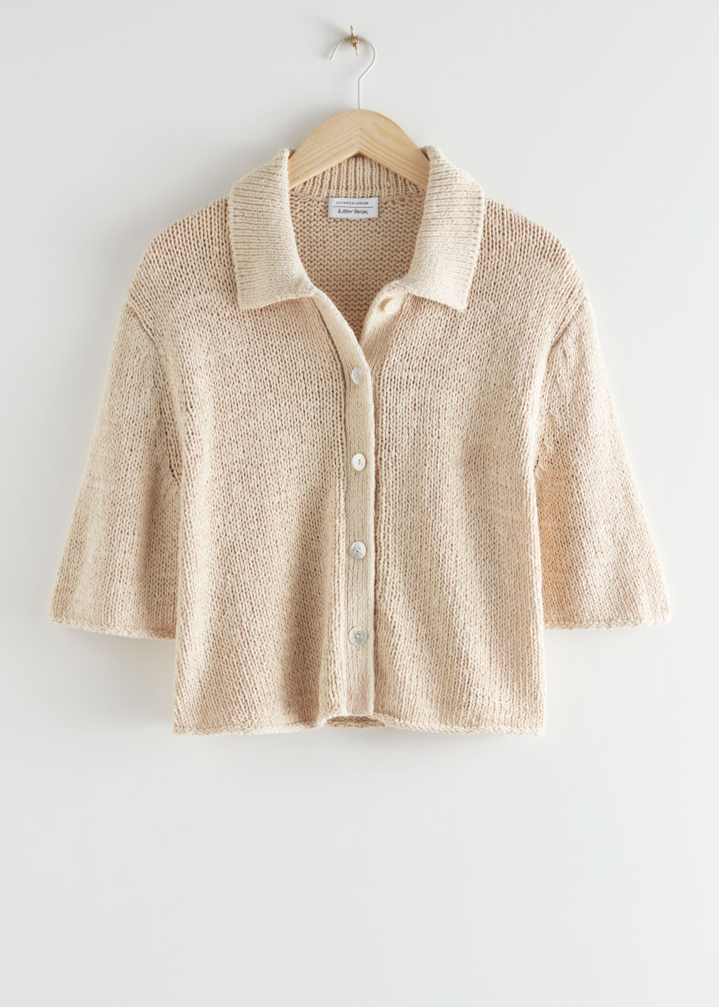 StillLife Front Image of Stories Boxy Short-Sleeved Cardigan in Beige
