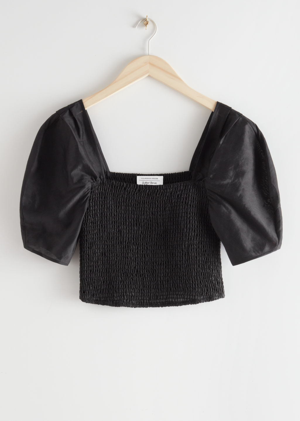 StillLife Front Image of Stories Smocked Puff Sleeve Top in Black