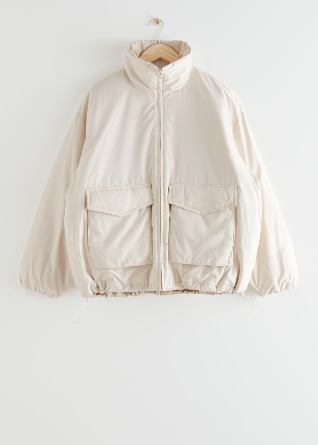 StillLife Front Image of Stories Boxy Padded High Collar Jacket in Beige