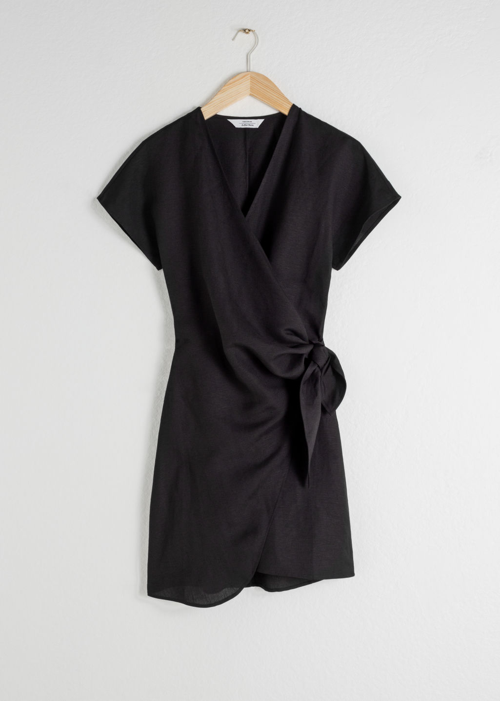 StillLife Front Image of Stories Linen Blend Wrap Mini Dress in Black
