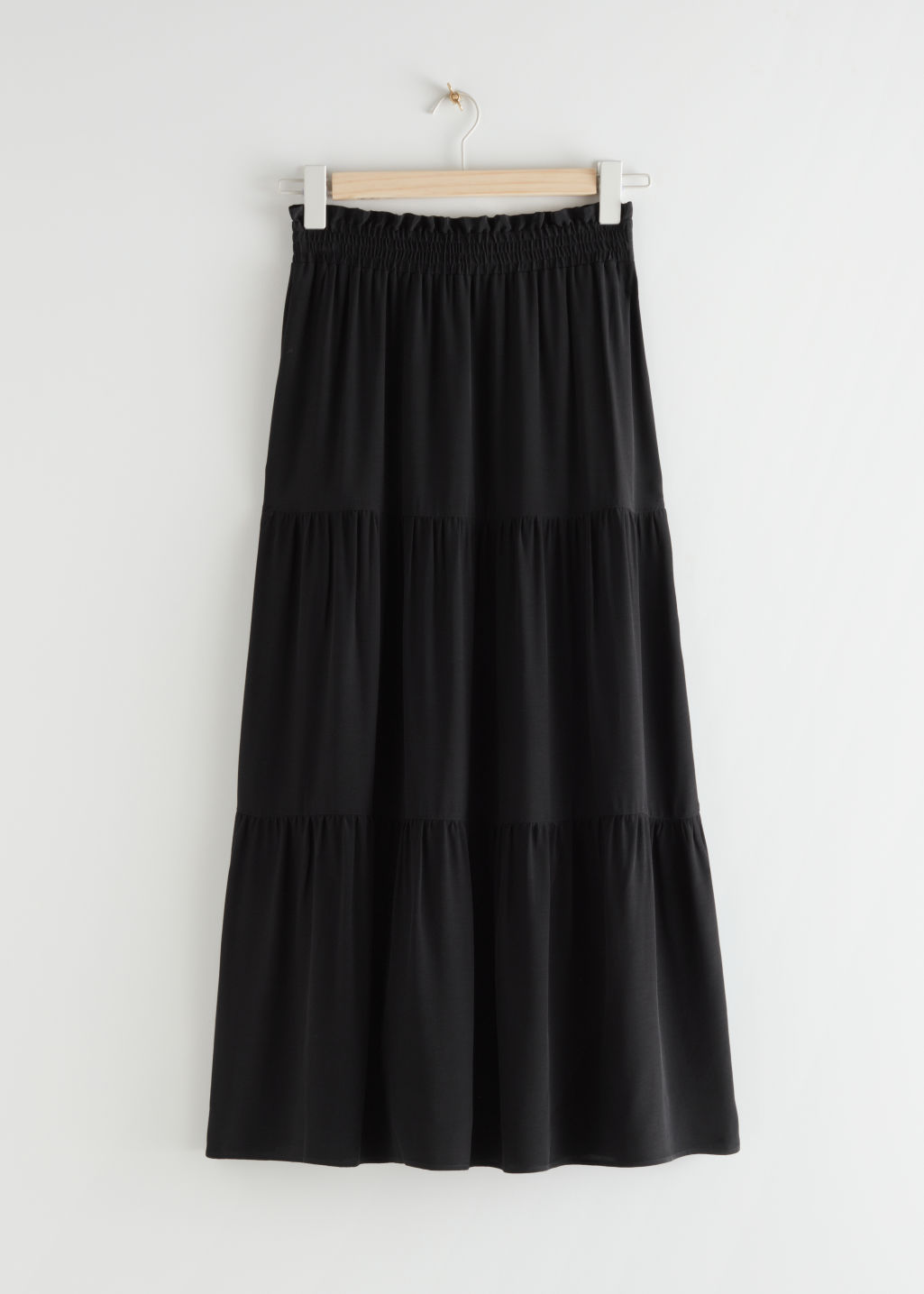 StillLife Front Image of Stories Smocked Waist Tiered Midi Skirt in Black