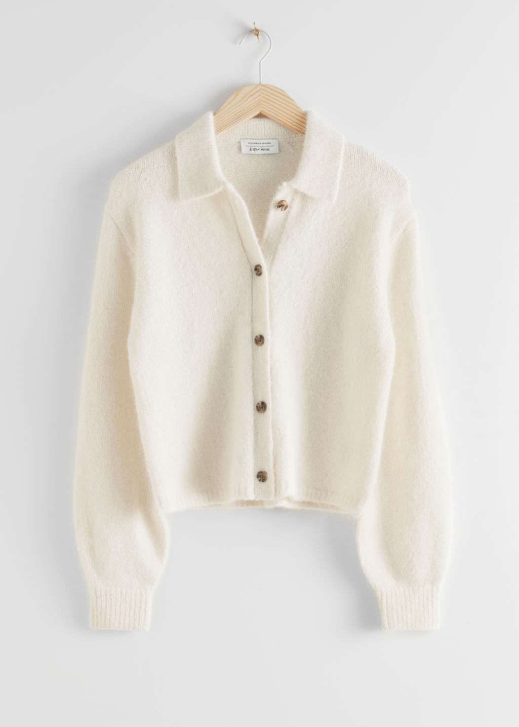 StillLife Front Image of Stories Wool Blend Tortoise Button Cardigan in White