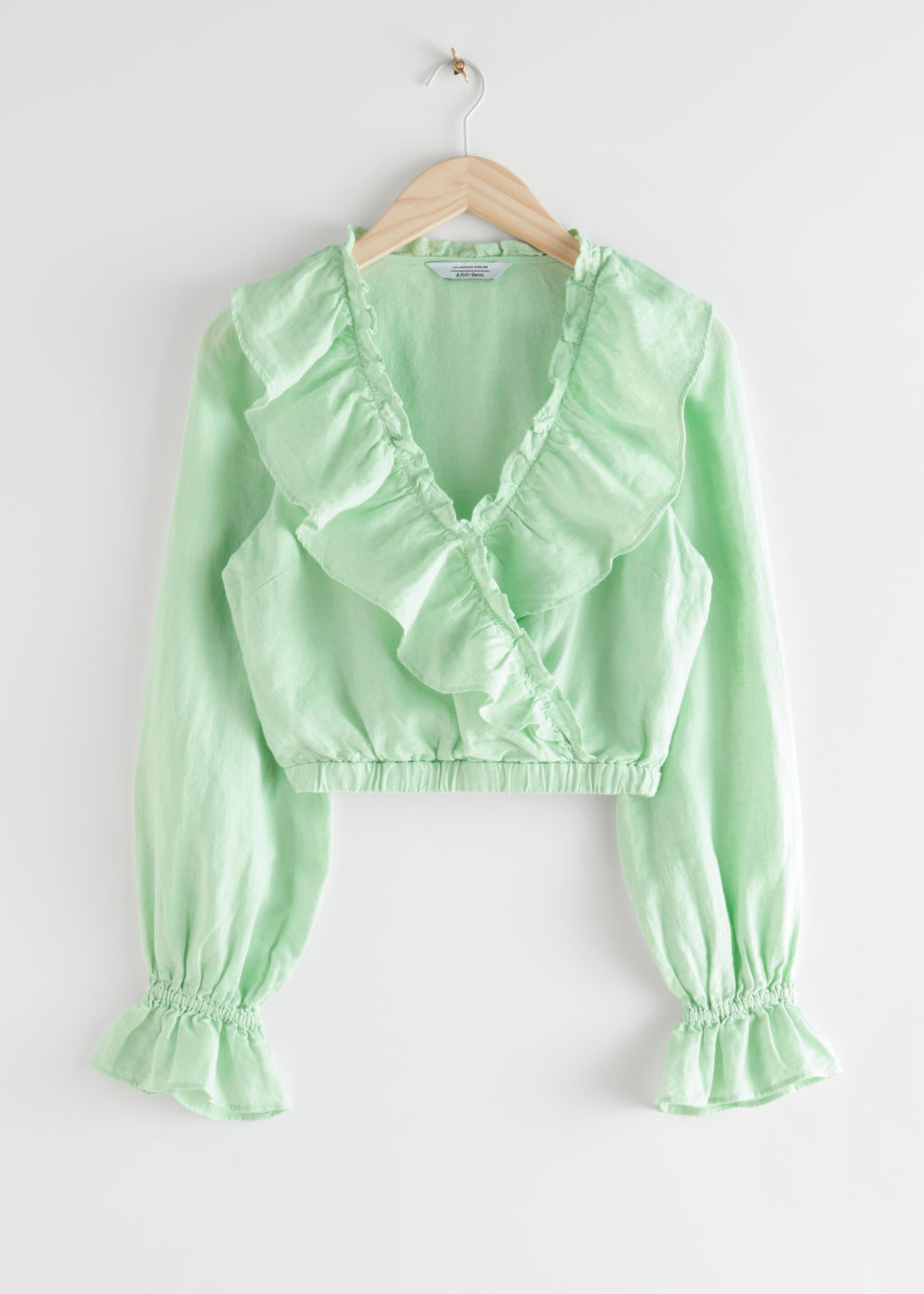 StillLife Front Image of Stories Linen Ruffle Top in Green