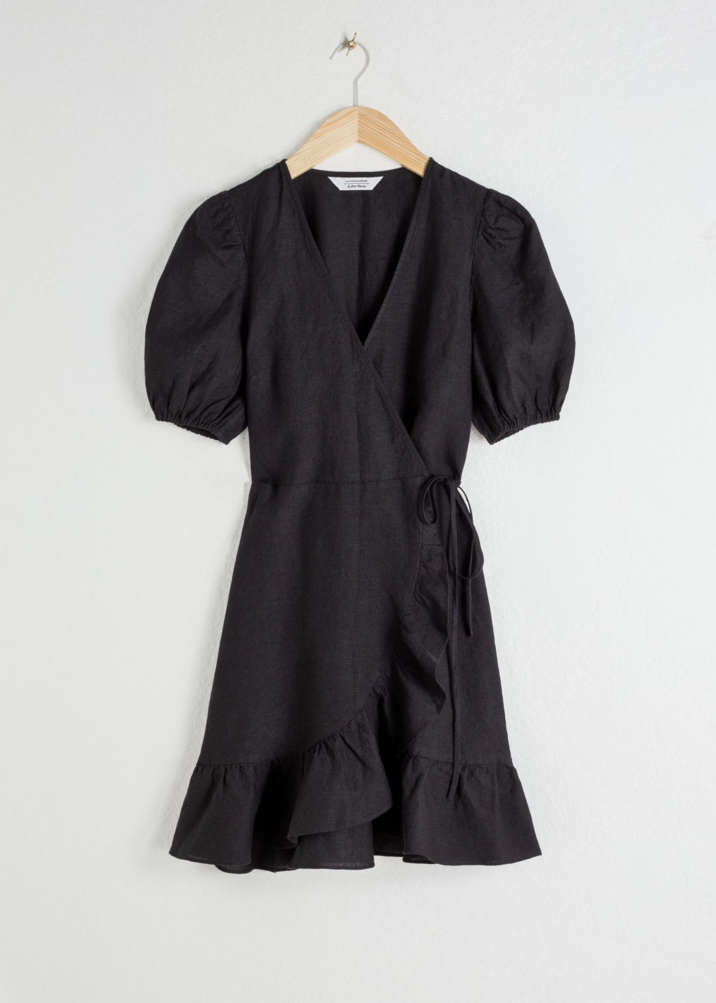 StillLife Front Image of Stories Puff Sleeve Linen Wrap Mini Dress in Black