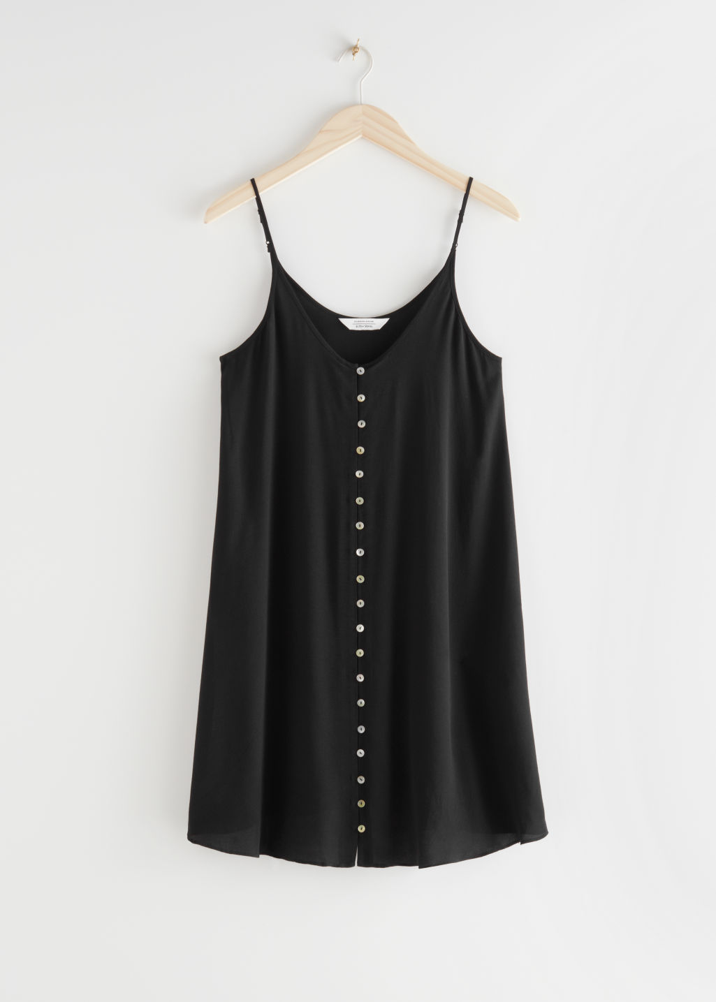 StillLife Front Image of Stories Flowy Buttoned Mini Dress in Black