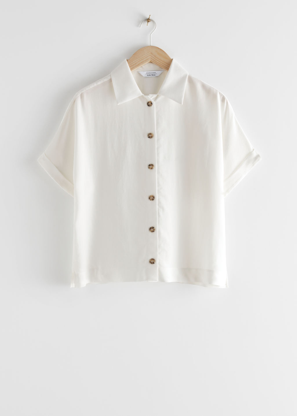 StillLife Front Image of Stories Boxy Short Sleeved Shirt in White
