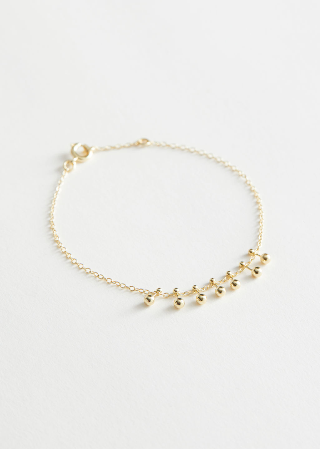 StillLife Front Image of Stories Stud Pendant Chain Bracelet in Gold