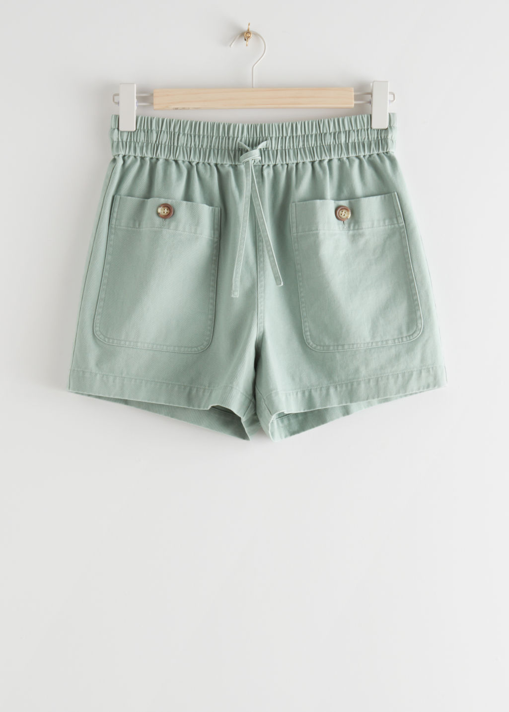 StillLife Front Image of Stories Relaxed Drawstring Shorts in Green