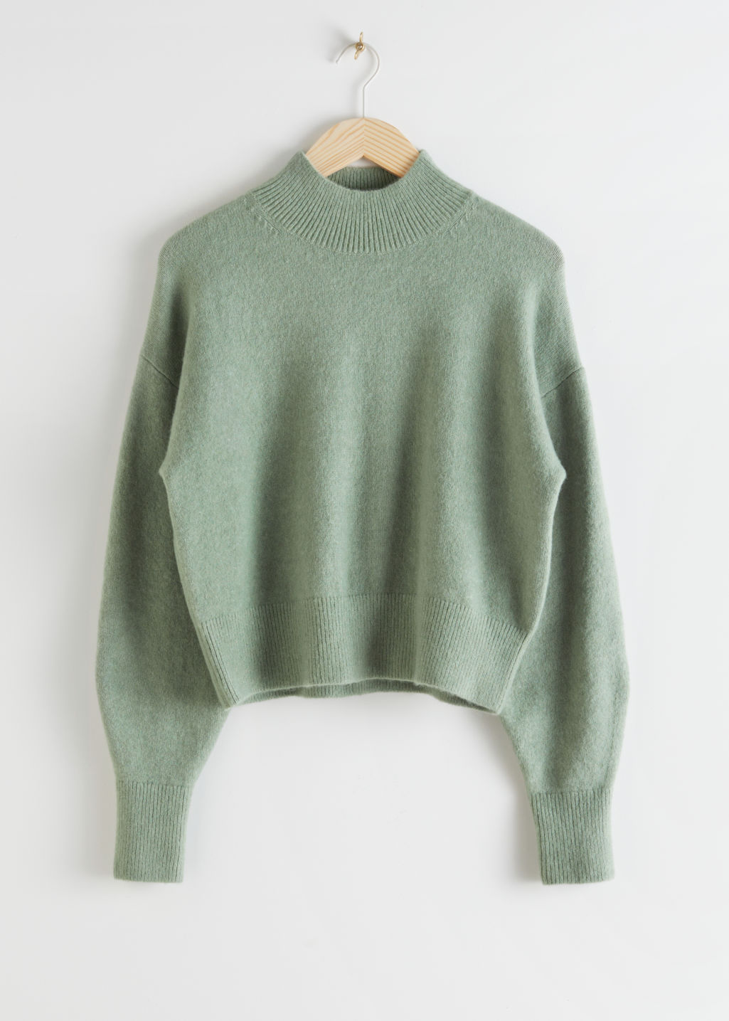 StillLife Front Image of Stories Mock Neck Sweater in Green