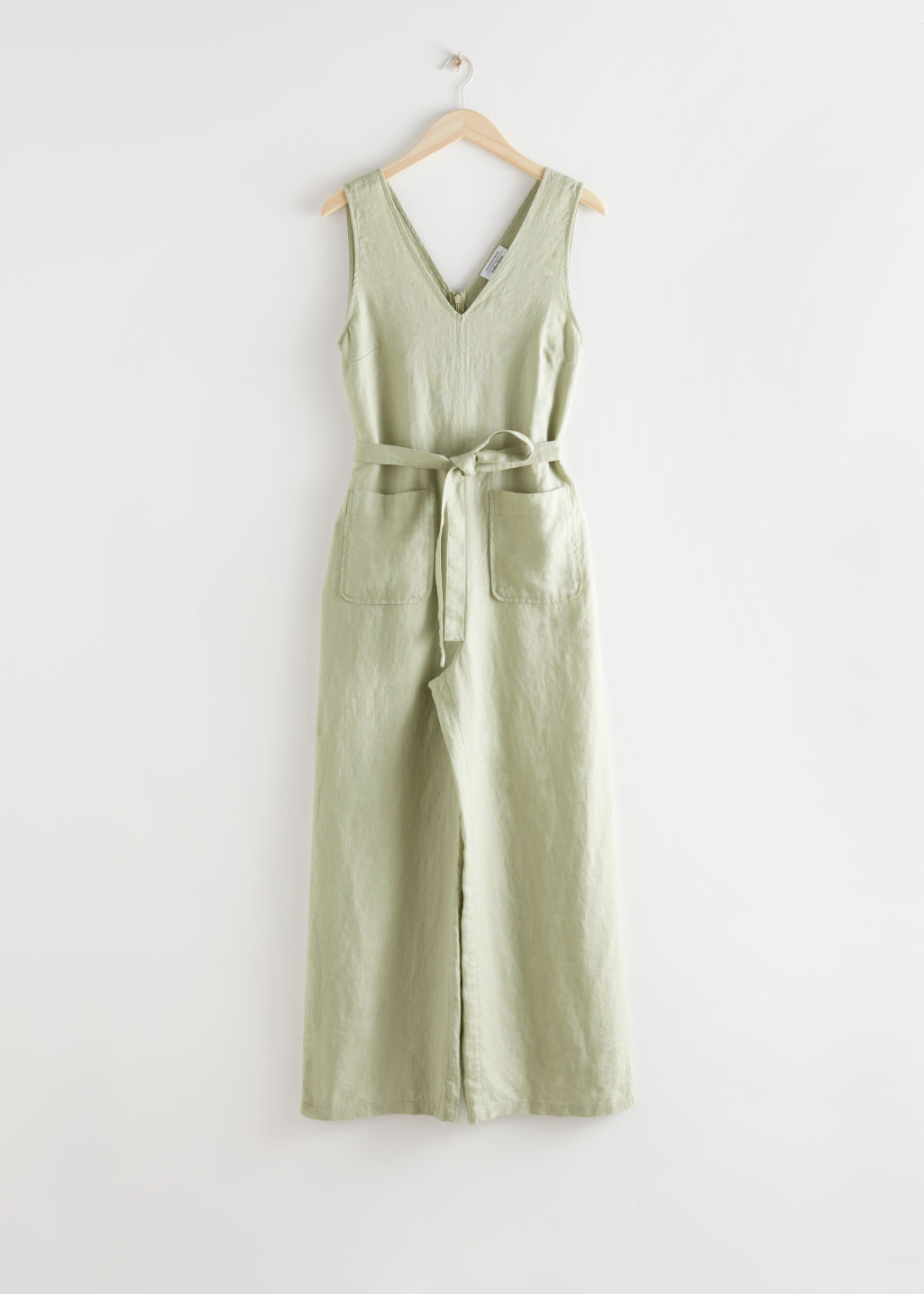 StillLife Front Image of Stories Oversized Belted Linen Jumpsuit in Green