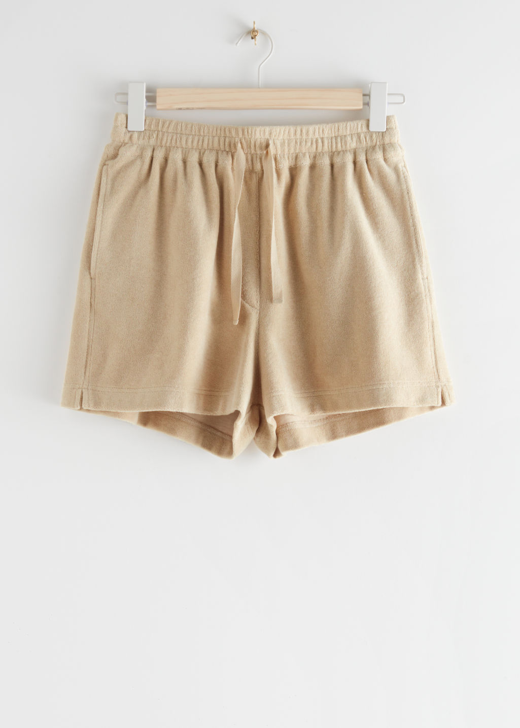 StillLife Front Image of Stories Drawstring Velour Shorts in Beige