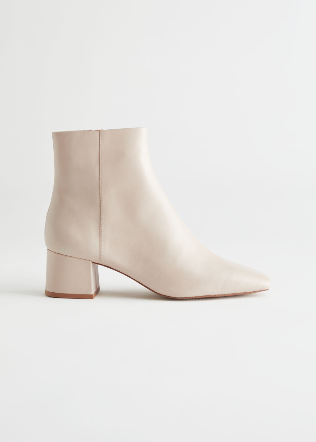 StillLife Left Image of Stories Leather Heeled Ankle Boots in Beige