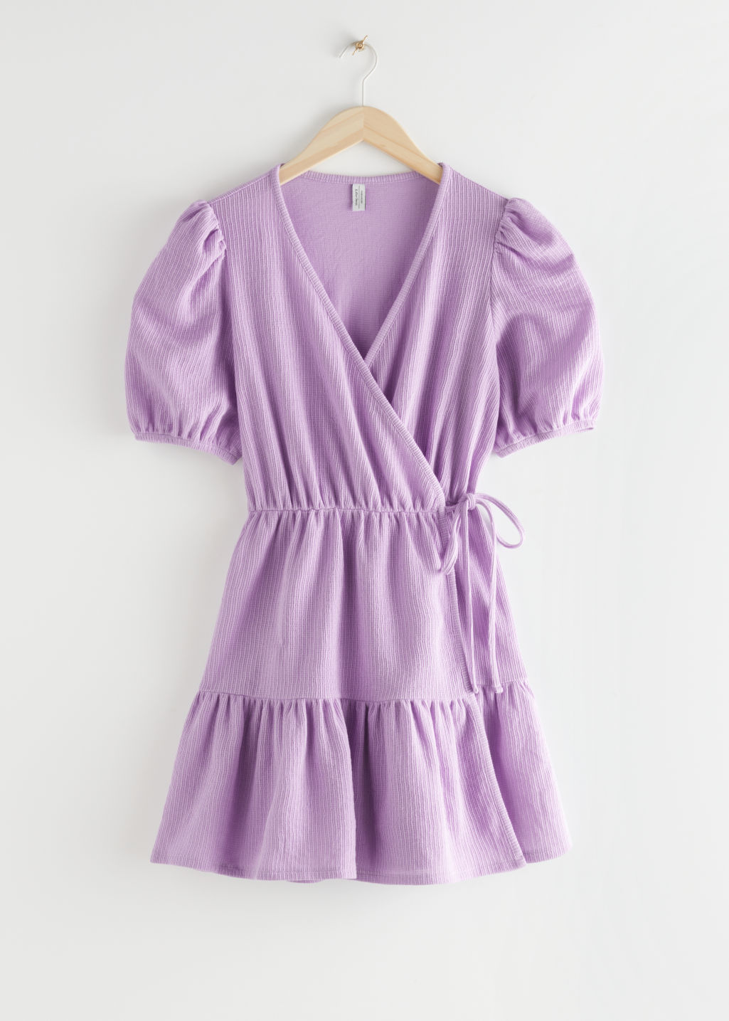 StillLife Front Image of Stories Puff Sleeve Wrap Mini Dress in Purple