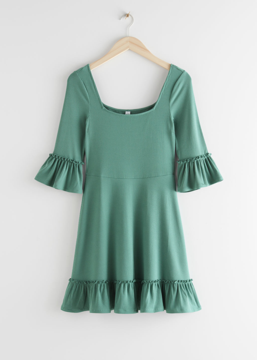 StillLife Front Image of Stories Ruffle Trim Mini Dress in Green