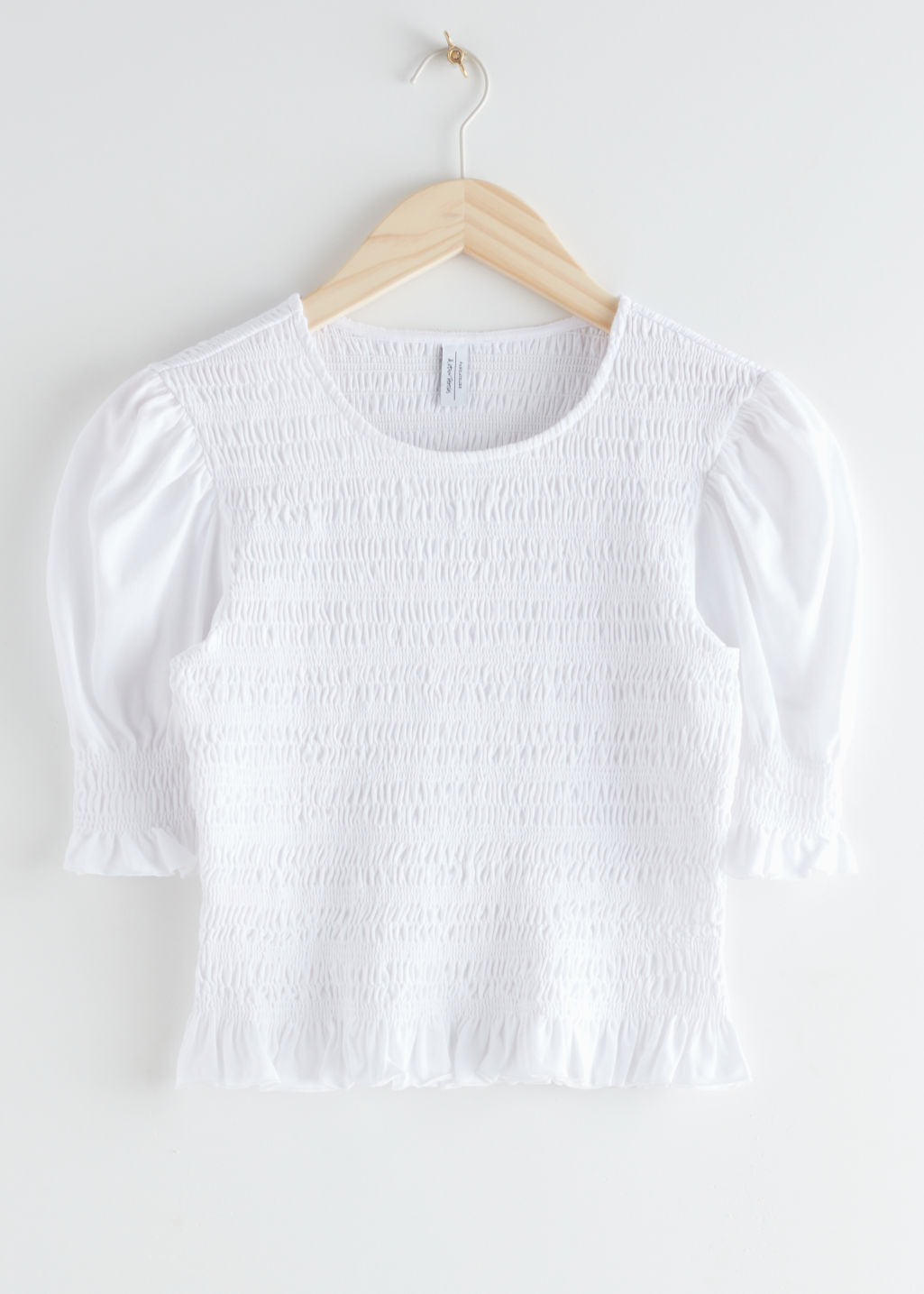 StillLife Front Image of Stories Smocked Puff Sleeve Crop Top in White