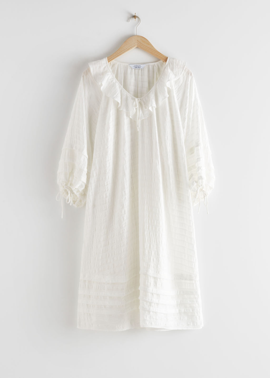 StillLife Front Image of Stories Oversized V-Neck Ruffle Midi Dress in White