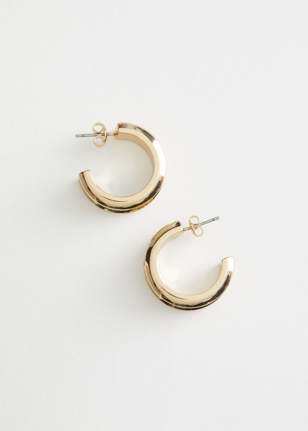 StillLife Front Image of Stories Chunky Open Back Hoop Earrings in Gold