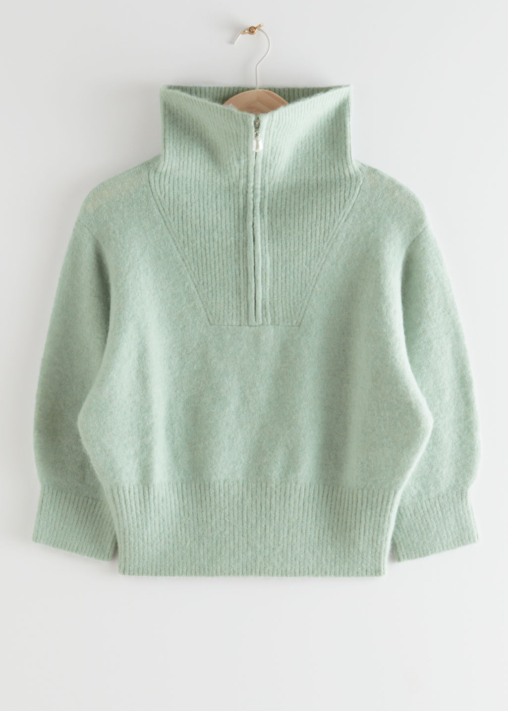 StillLife Front Image of Stories Fuzzy Zip Collar Knit Top in Green
