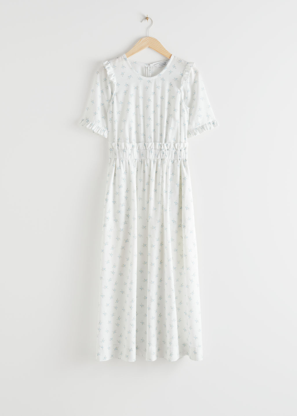 StillLife Front Image of Stories Lyocell Blend Ruffle Maxi Dress in White