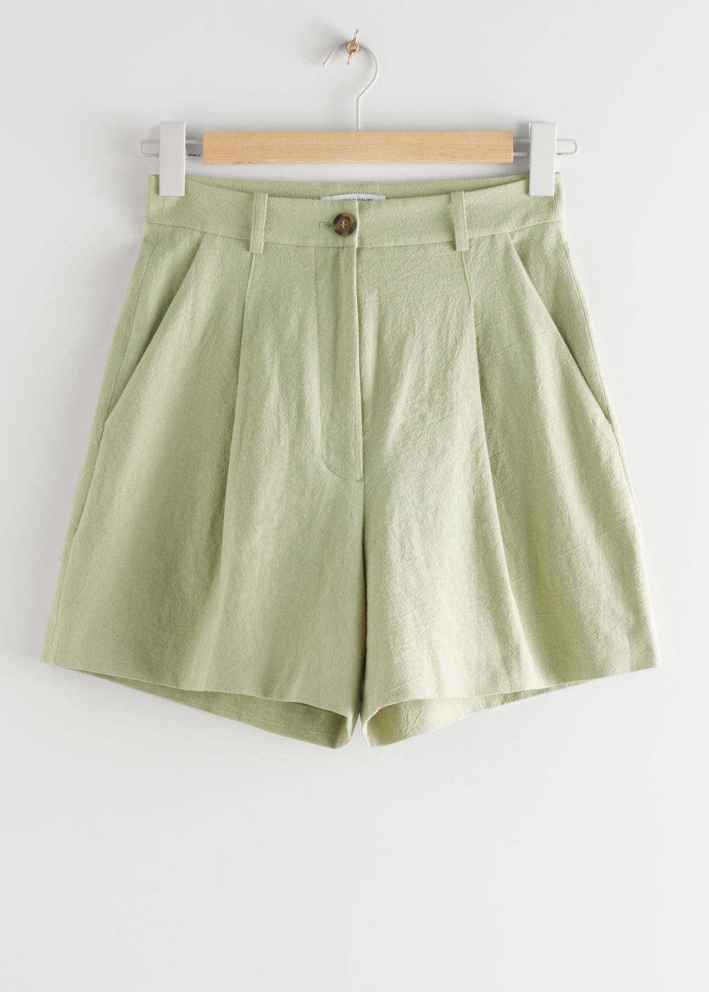 StillLife Front Image of Stories High Waisted Linen-Blend Shorts in Green