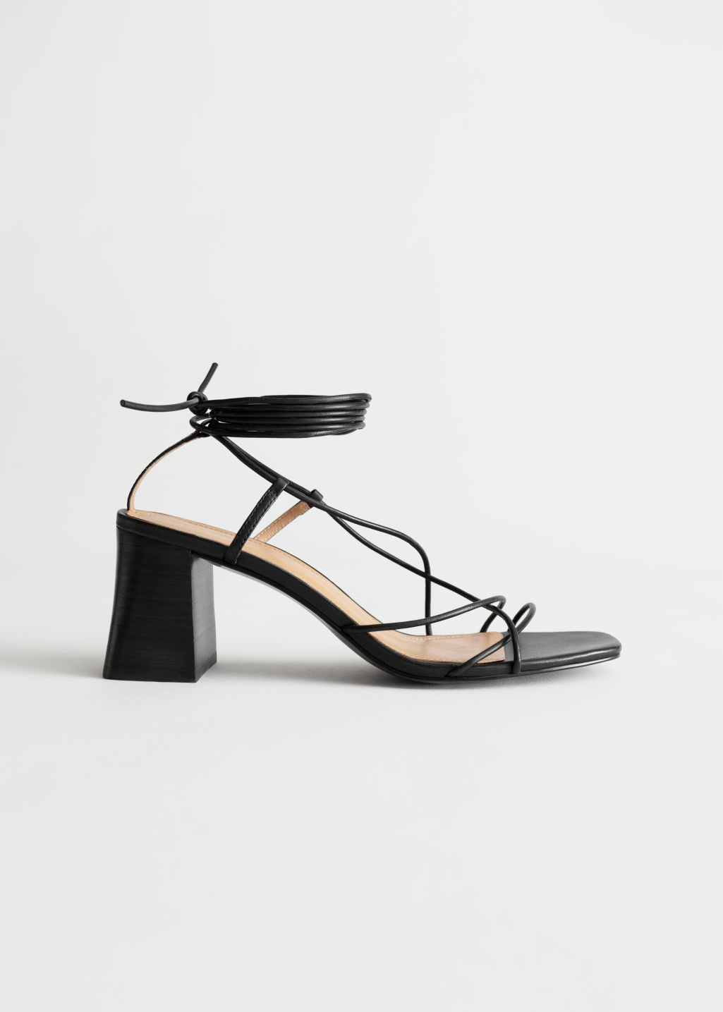 StillLife Left Image of Stories Leather Strappy Lace Up Heeled Sandals in Black