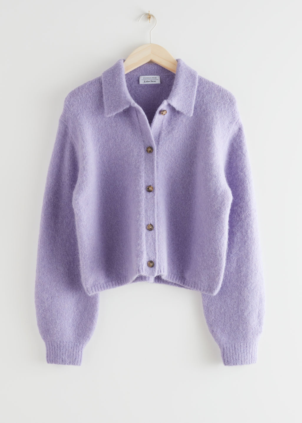 StillLife Front Image of Stories Wool Blend Tortoise Button Cardigan in Purple