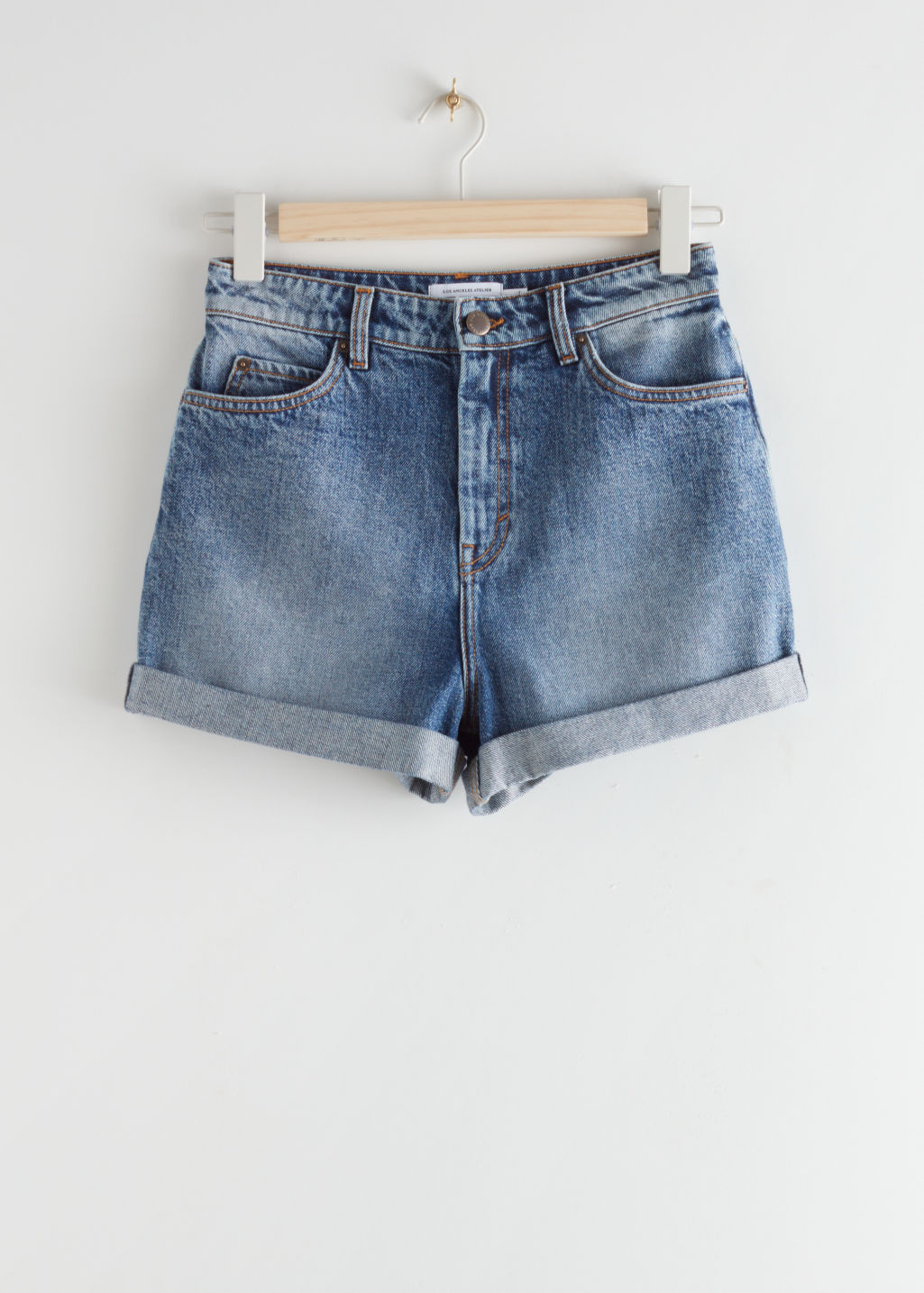StillLife Front Image of Stories Rolled Hem Denim Shorts in Blue