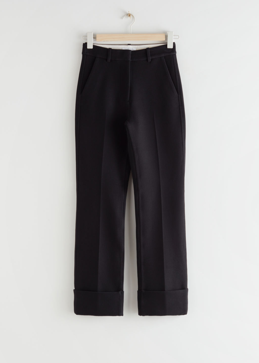 StillLife Front Image of Stories Cuffed Hem Trousers in Black