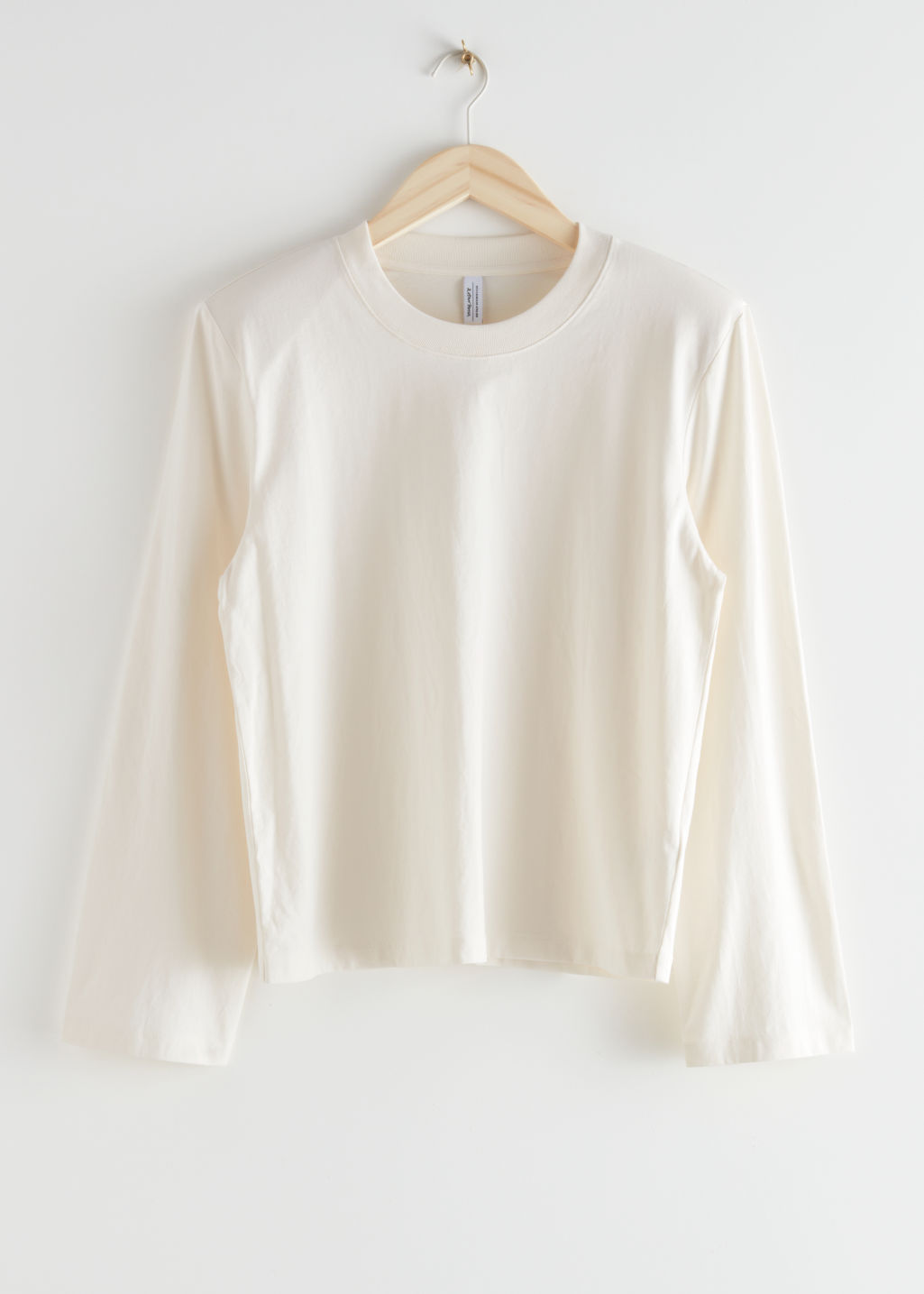 StillLife Front Image of Stories Relaxed Padded Shoulder Top in White