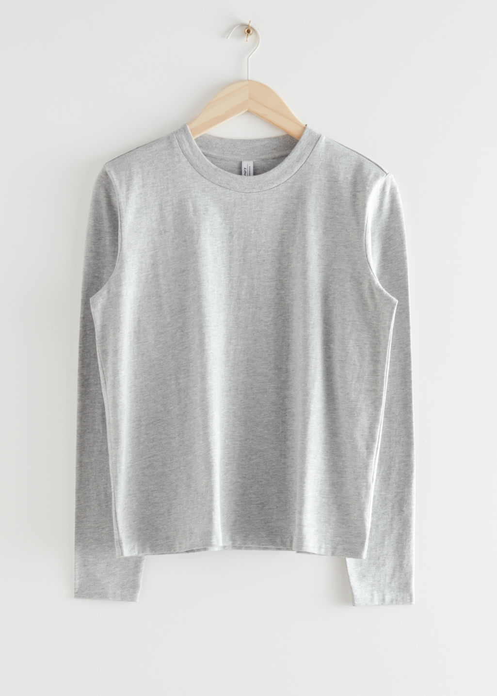 StillLife Front Image of Stories Organic Cotton Long Sleeve T-Shirt in Grey