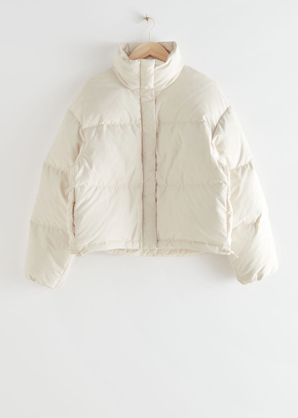 StillLife Front Image of Stories Short Puffer Jacket in Beige