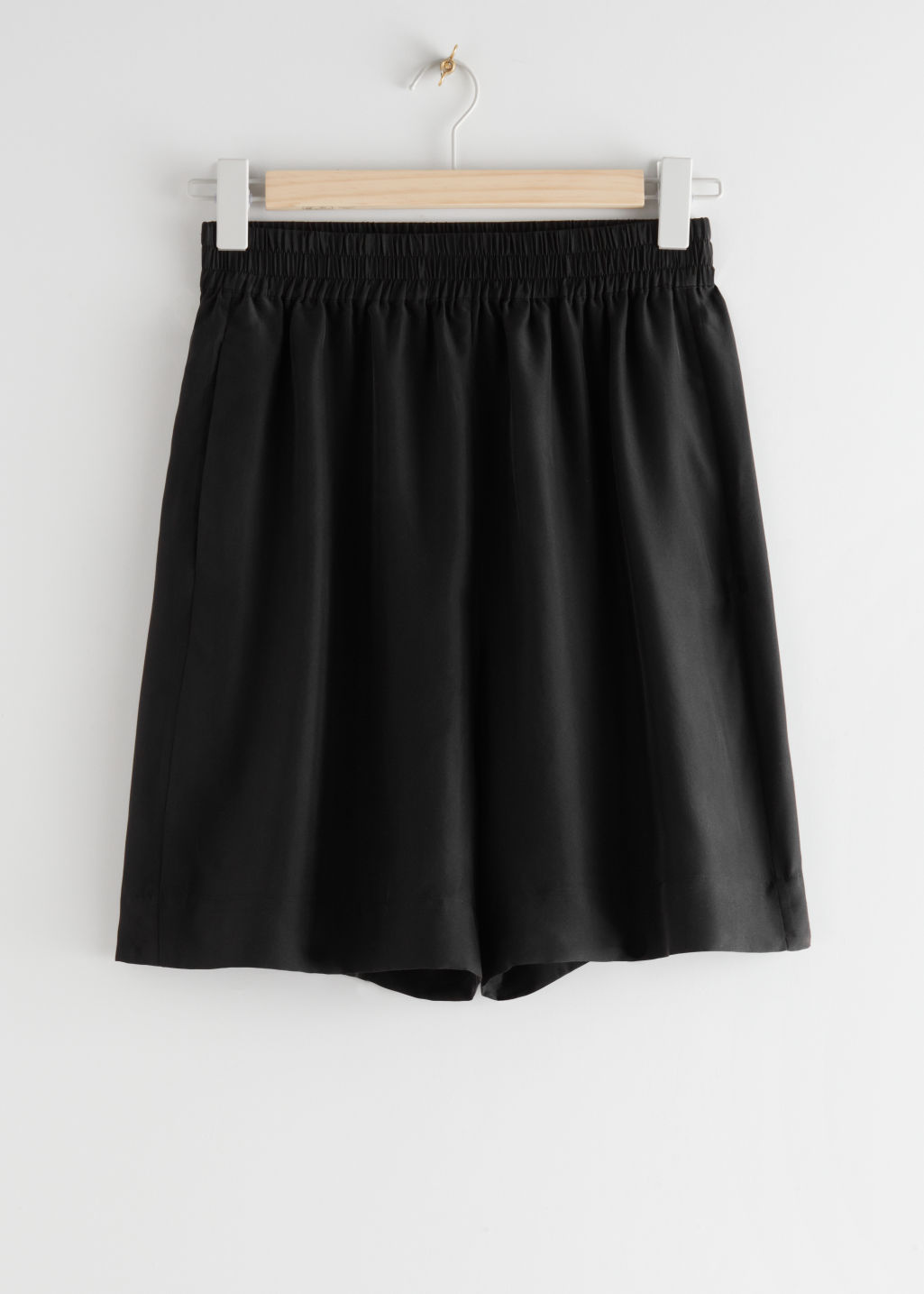 StillLife Front Image of Stories Mulberry Silk Shorts in Black