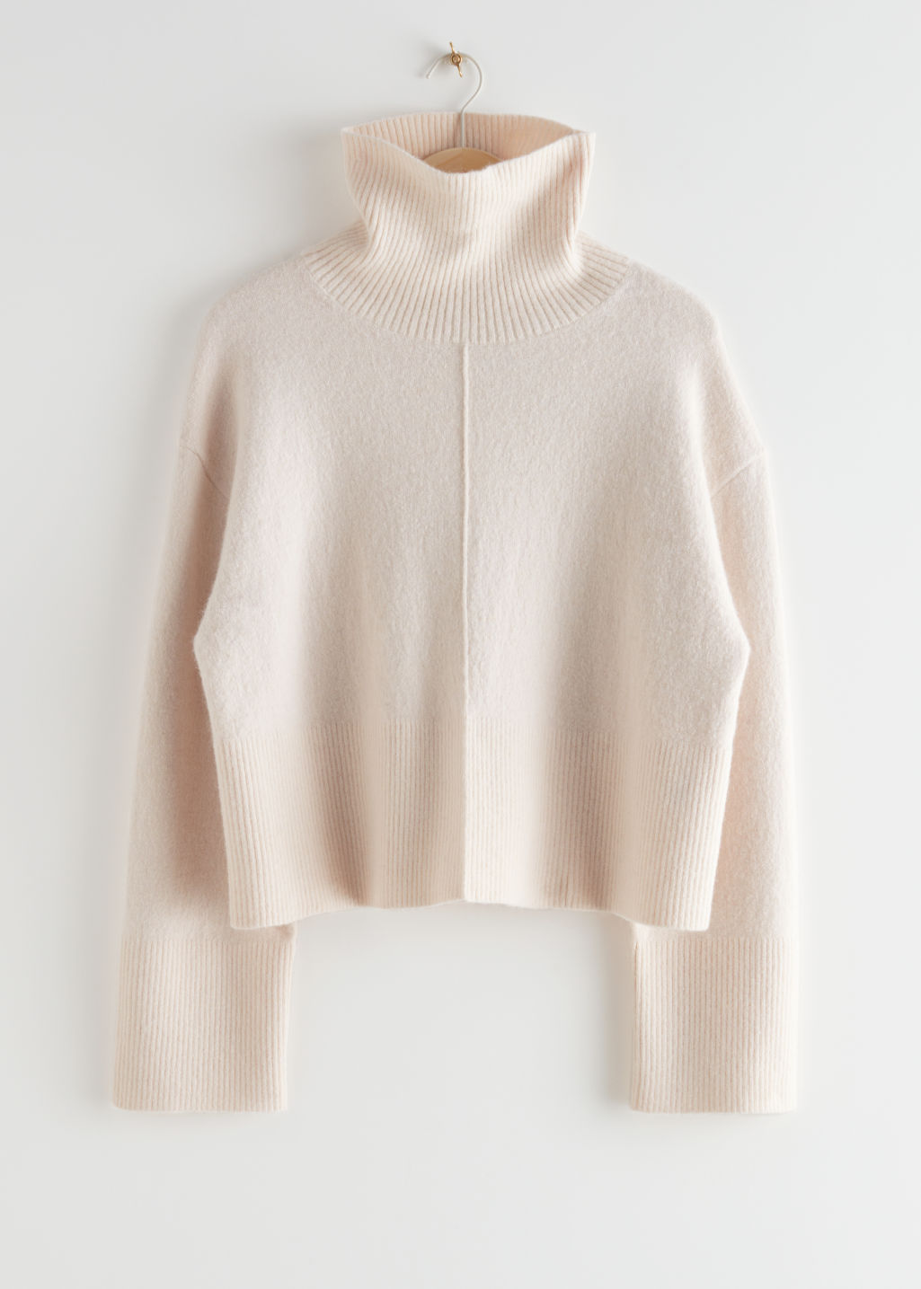 StillLife Front Image of Stories Cropped Turtleneck Knit Jumper in Beige