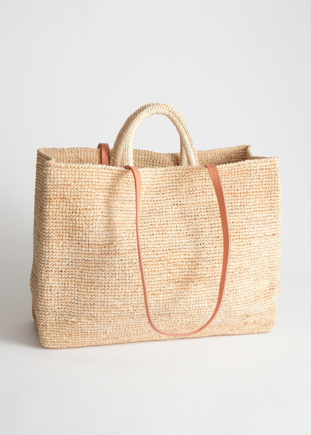 StillLife Front Image of Stories Large Woven Straw Tote in Beige