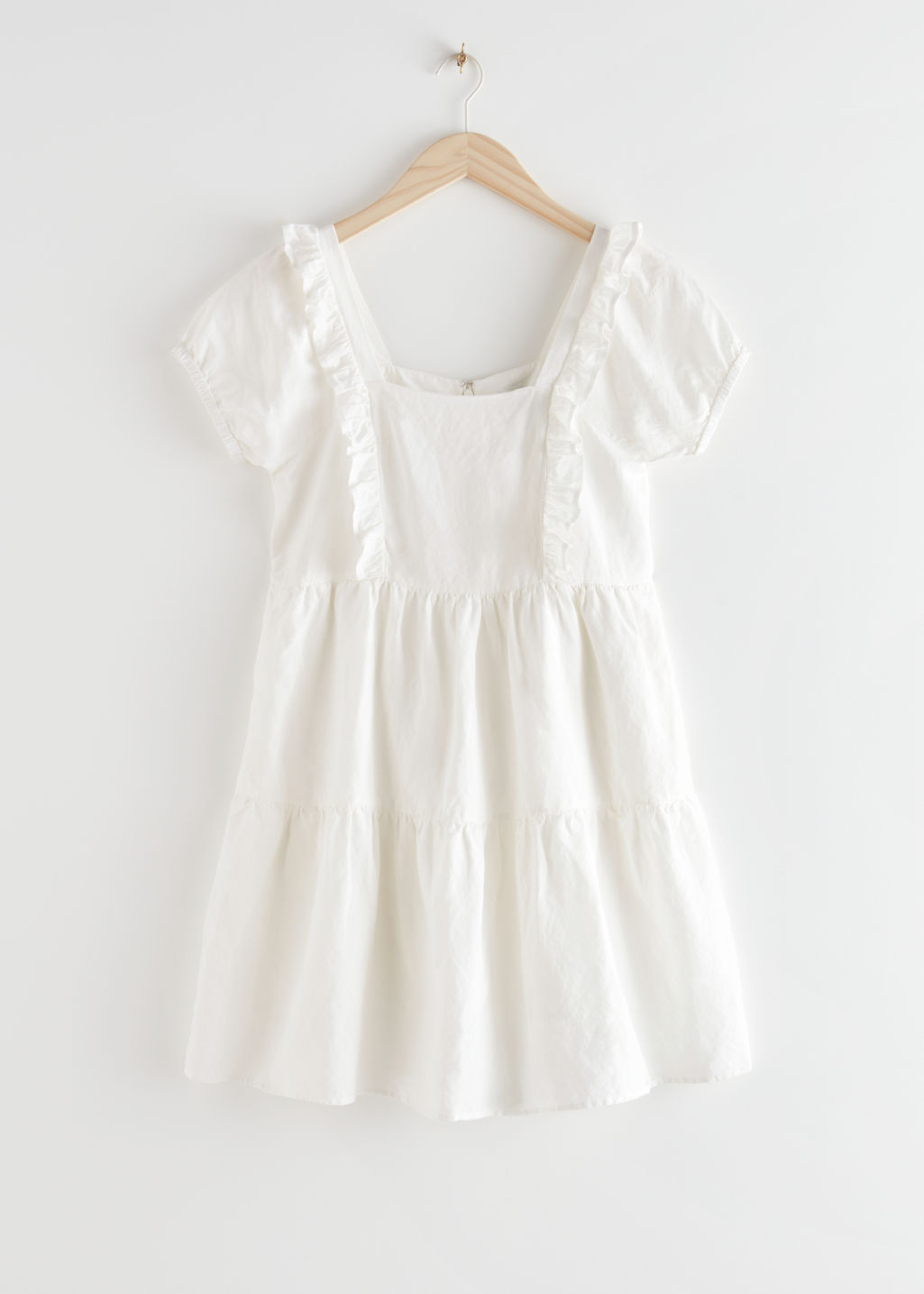StillLife Front Image of Stories Tiered Ruffle Mini Dress in White