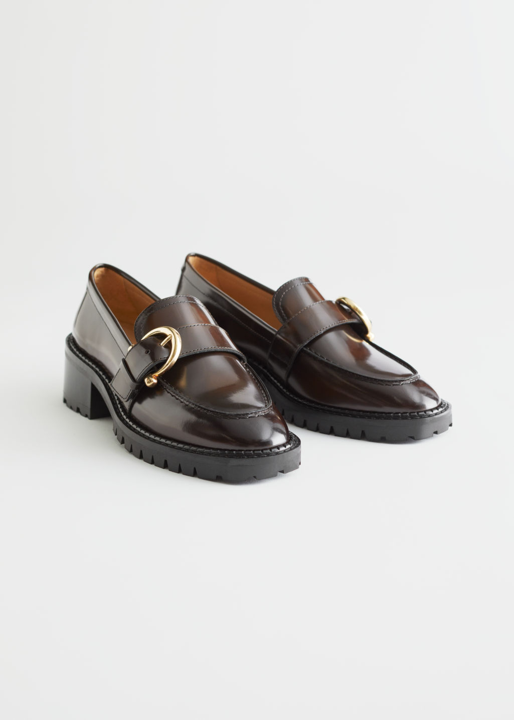 StillLife Front Image of Stories Buckled Leather Heeled Loafers in Brown