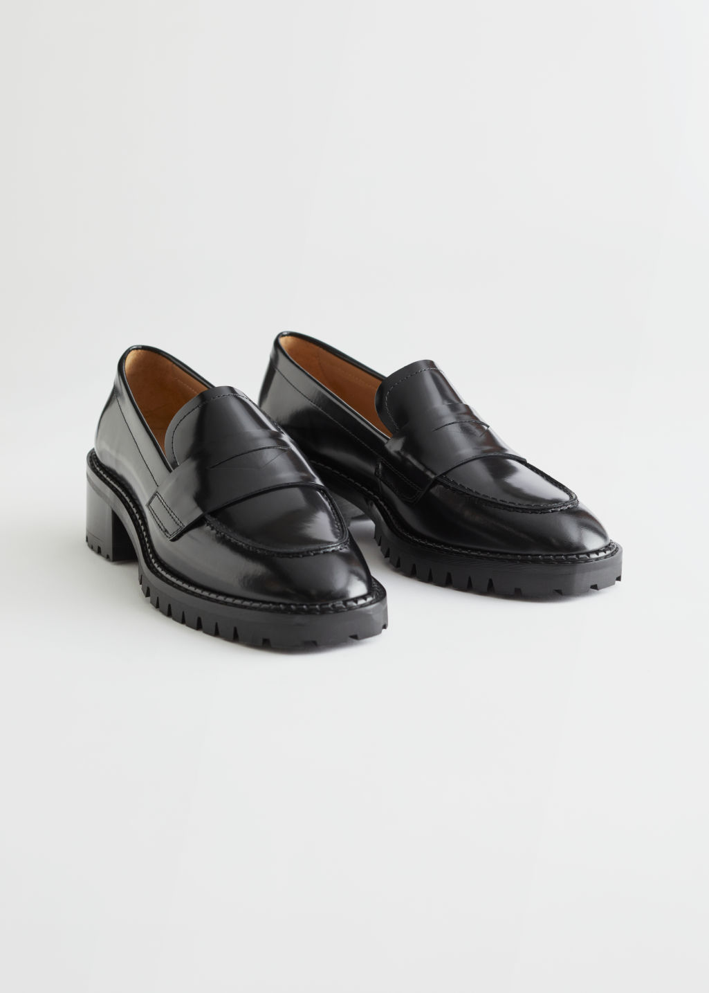 StillLife Front Image of Stories Heeled Leather Penny Loafers in Black