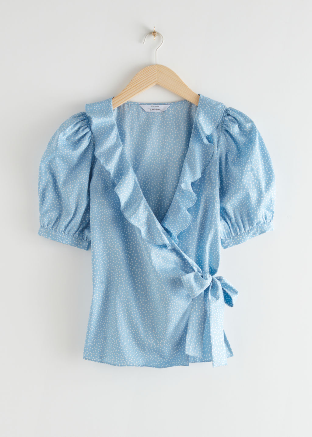 StillLife Front Image of Stories Frilled Wrap Blouse in Blue