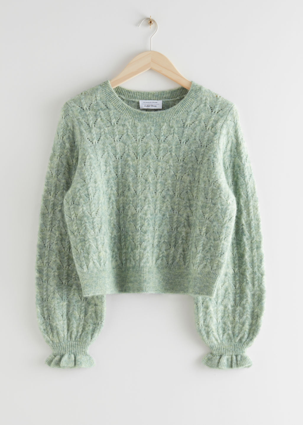 StillLife Front Image of Stories Alpaca Blend Ruffled Cable Knit Sweater in Green