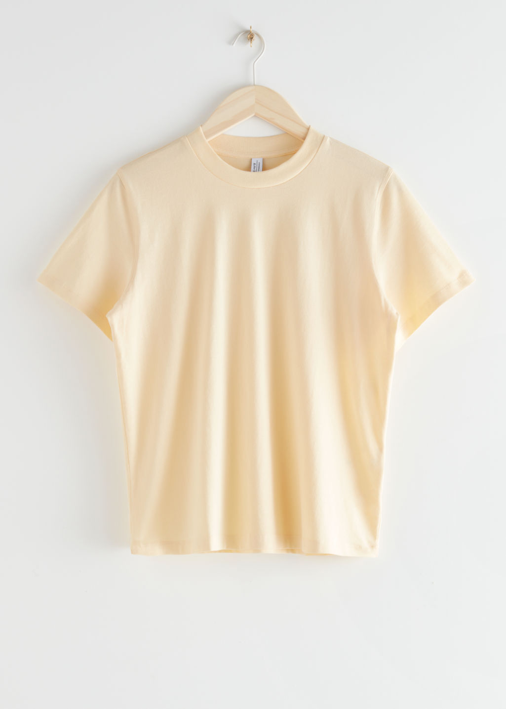 StillLife Front Image of Stories Boxy Organic Cotton T-Shirt in Yellow