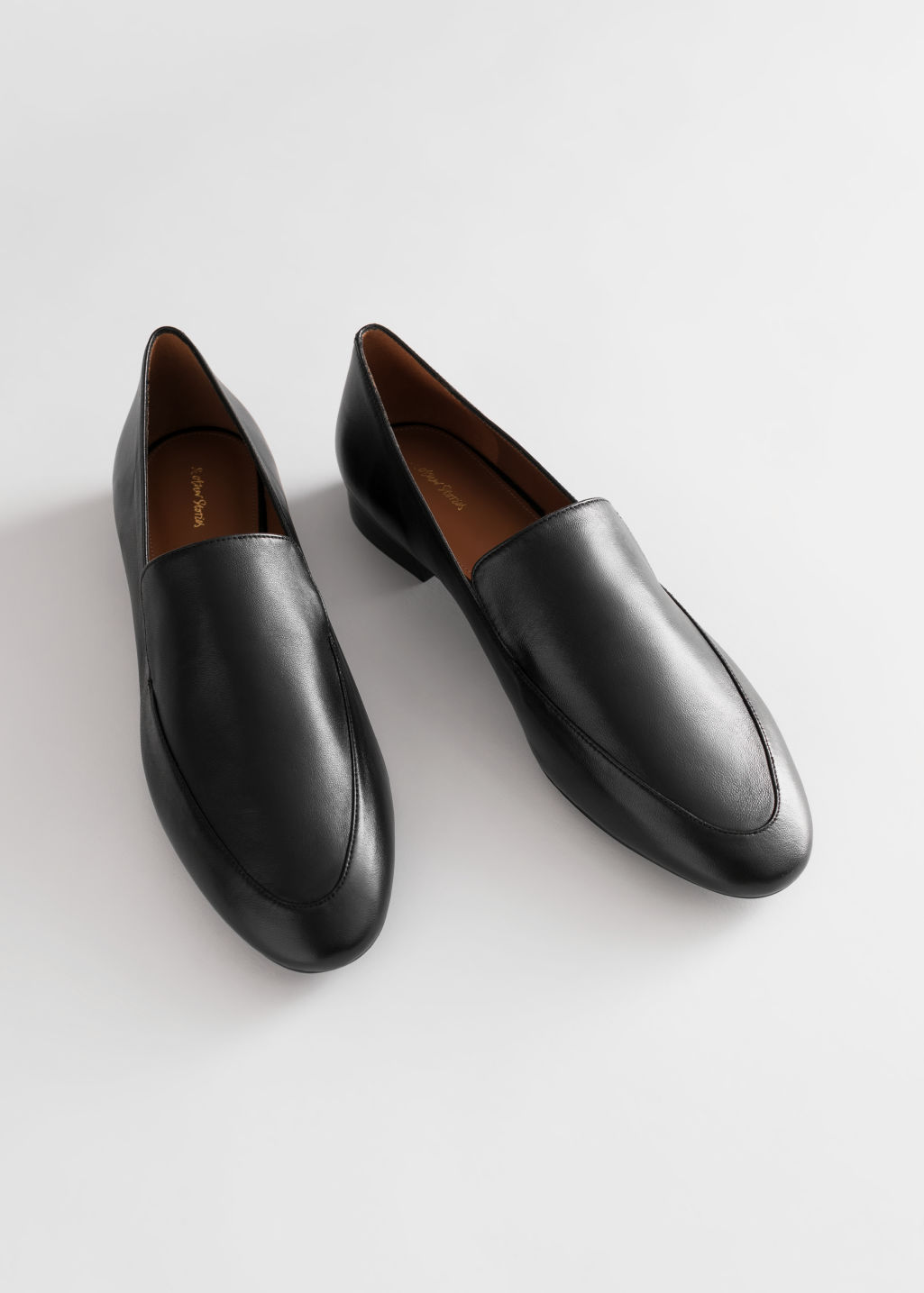StillLife Top Image of Stories Smooth Leather Classic Loafers in Black