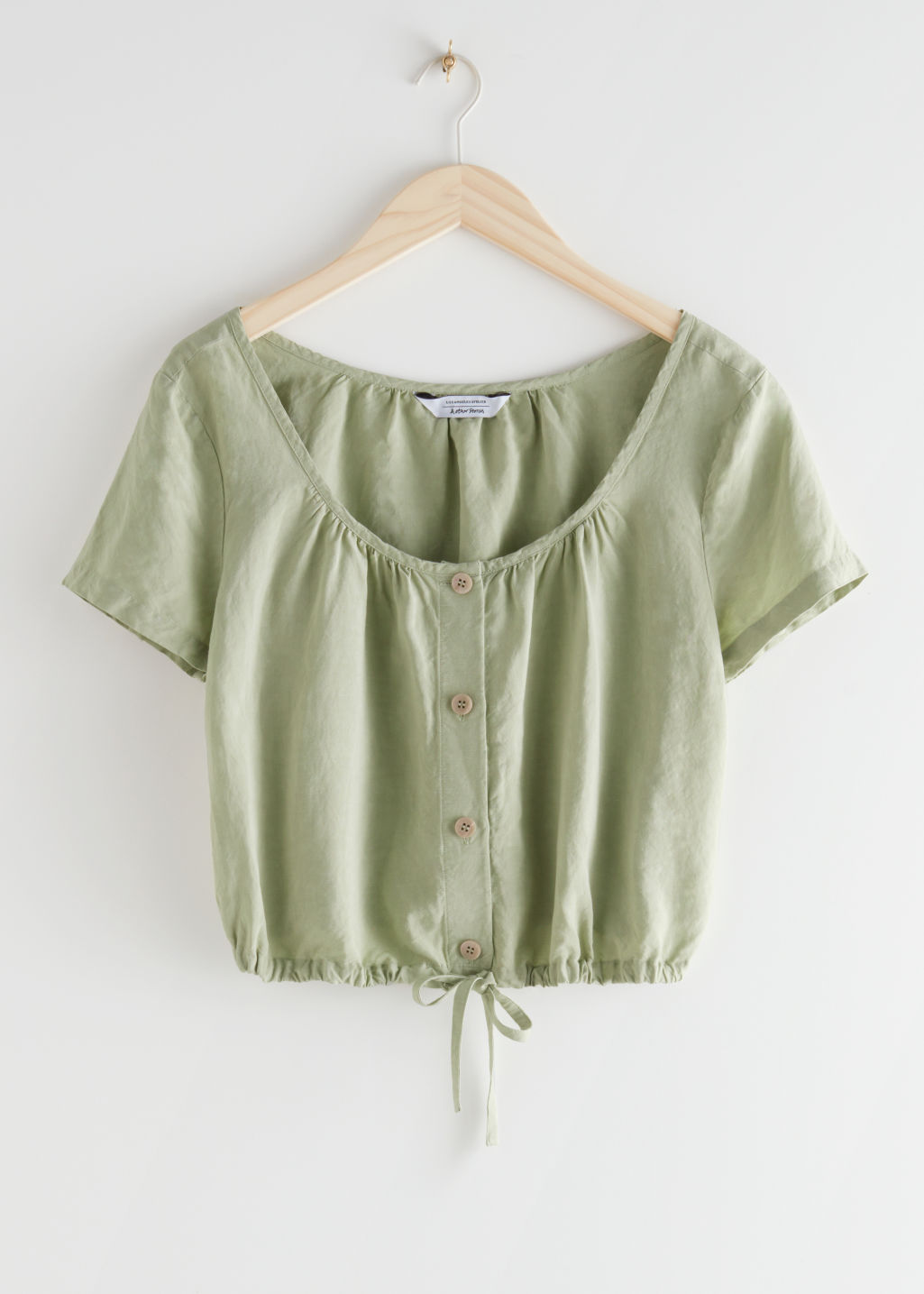 StillLife Front Image of Stories Relaxed Drawstring Crop Top in Green