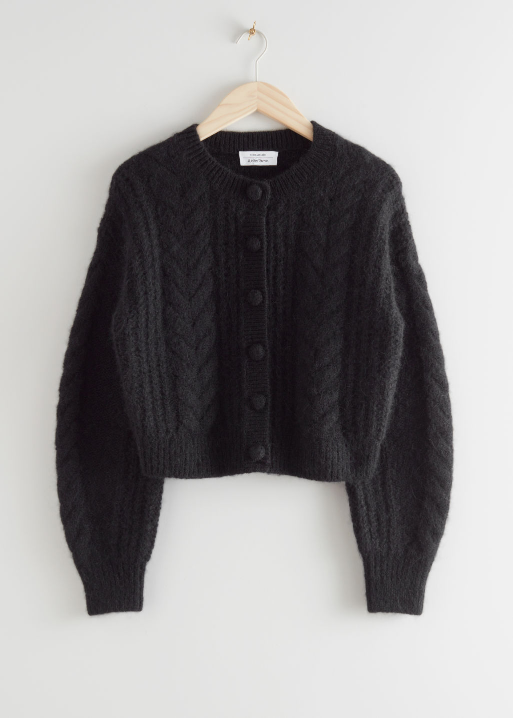 StillLife Front Image of Stories Cropped Button Up Knit Sweater in Black