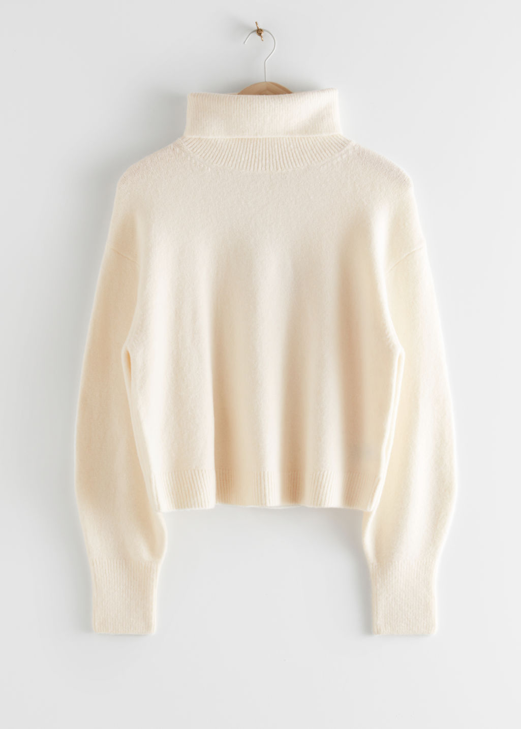 StillLife Front Image of Stories Oversized Cut Out Turtleneck Sweater in White