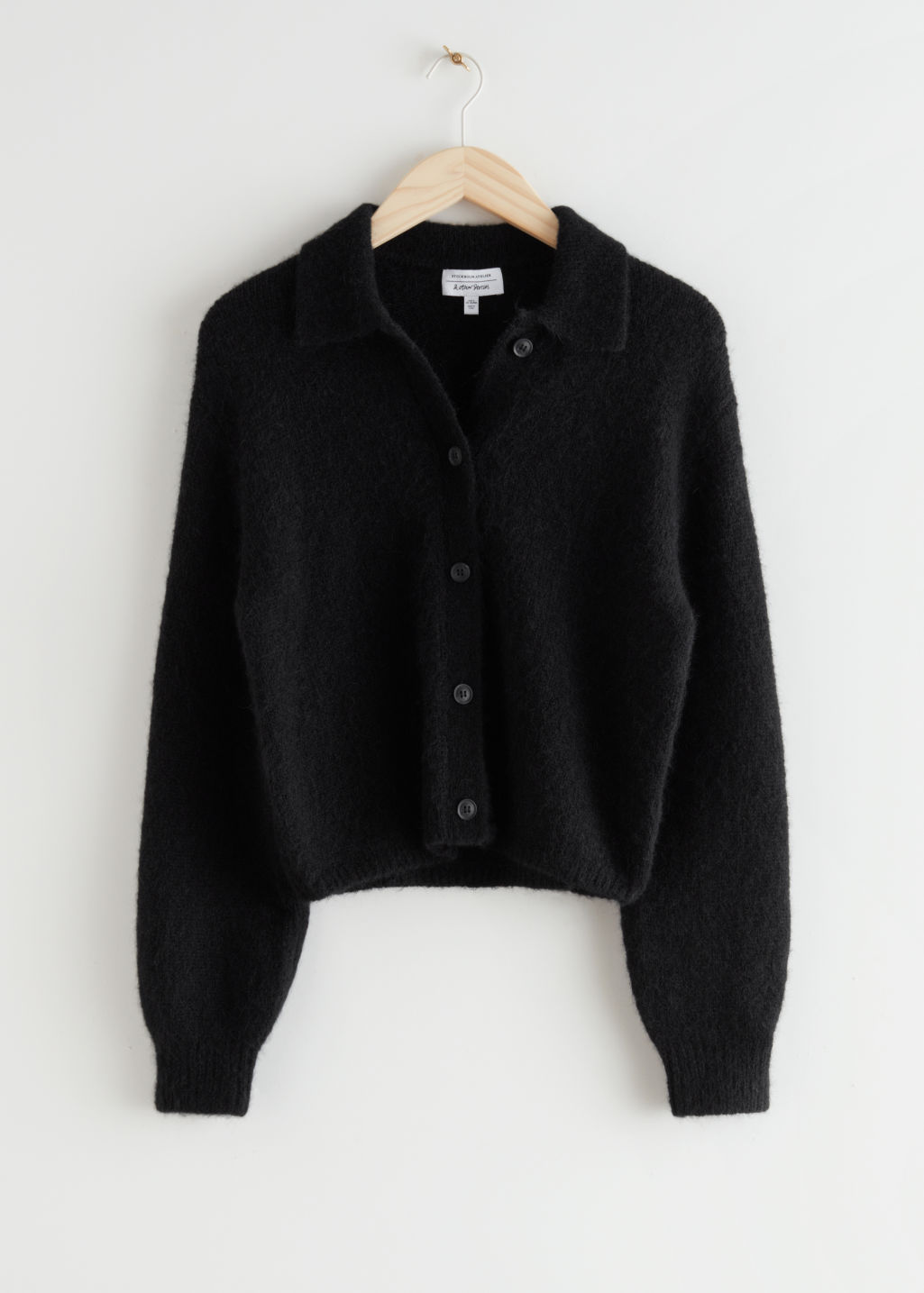 StillLife Front Image of Stories Wool Blend Tortoise Button Cardigan in Black