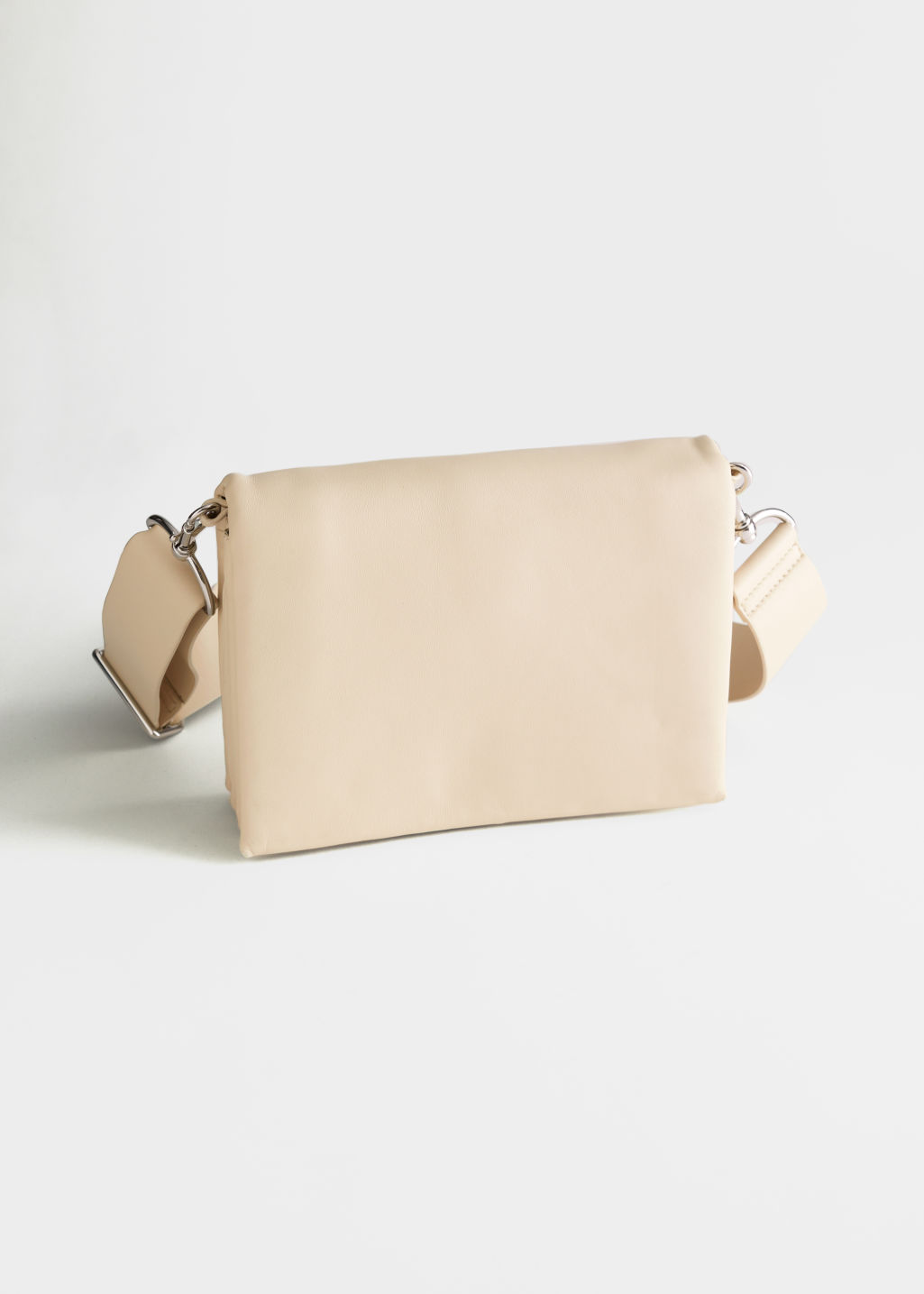 StillLife Left Image of Stories Leather Crossbody Utility Bag in Beige