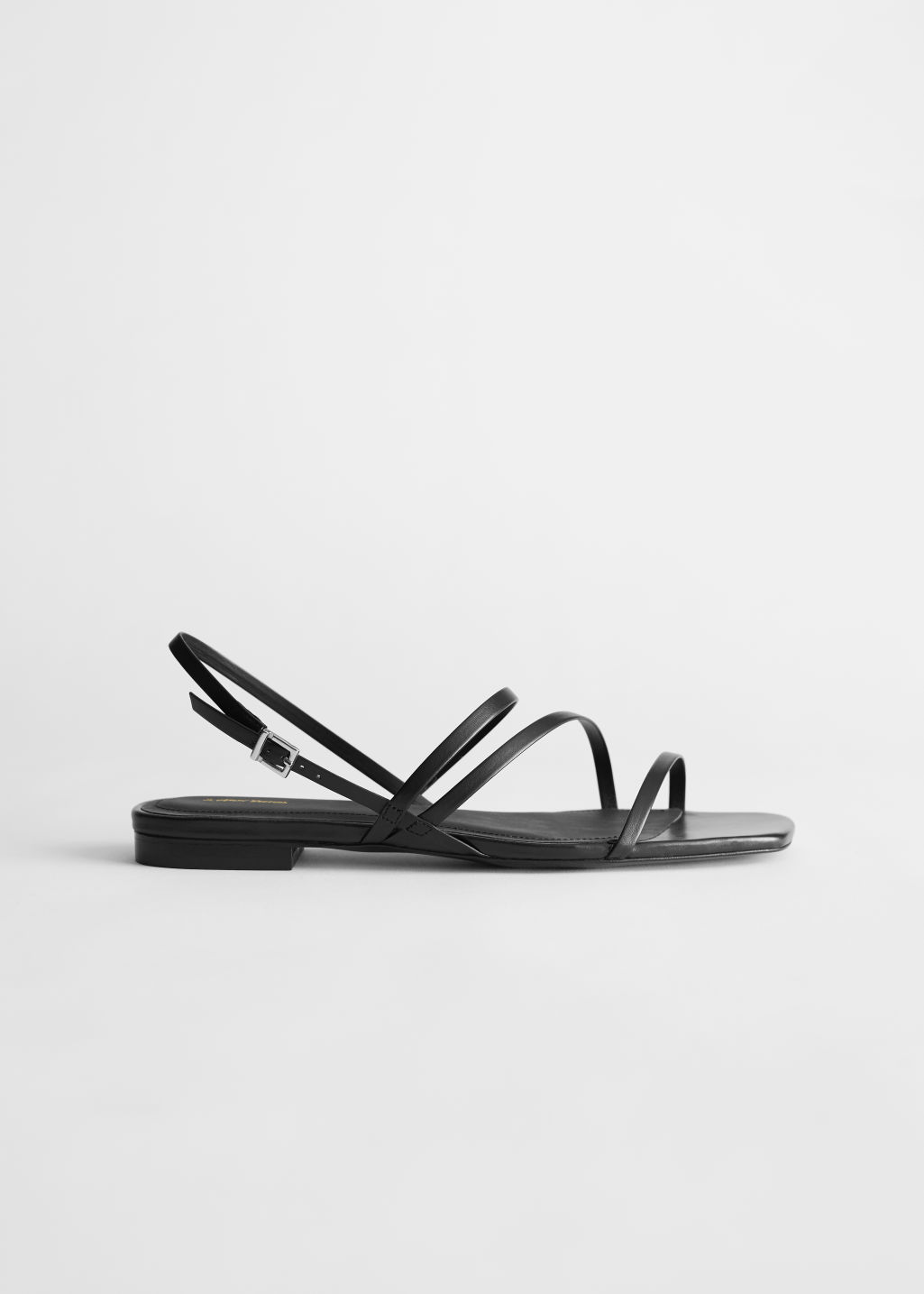 StillLife Left Image of Stories Strappy Leather Slingback Sandals in Black