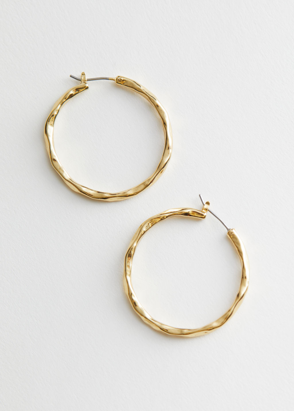 StillLife Front Image of Stories Hammered Hoop Earrings in Gold
